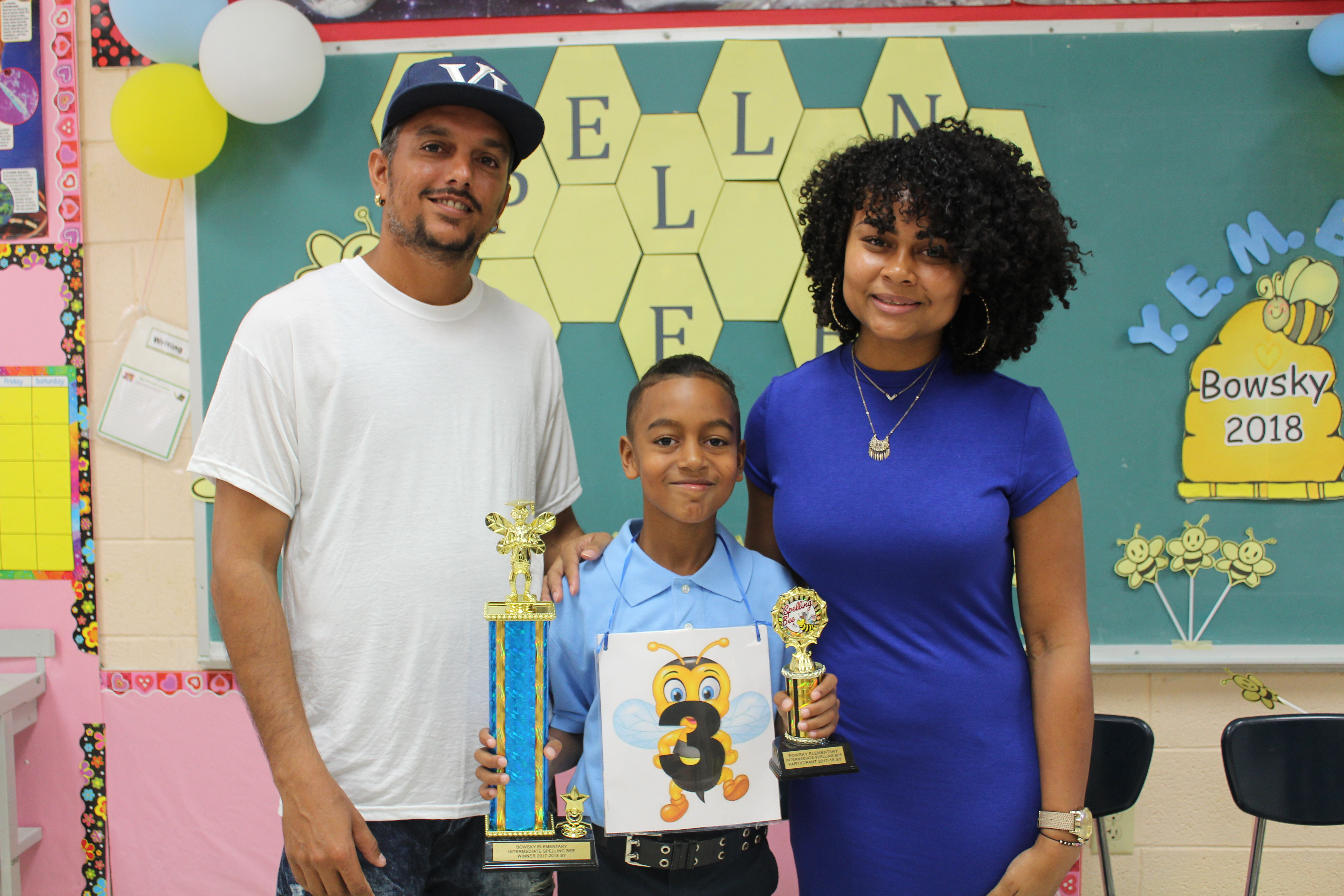 Bowsky Spelling Bee Champ Gequan Aubain and parents.JPG