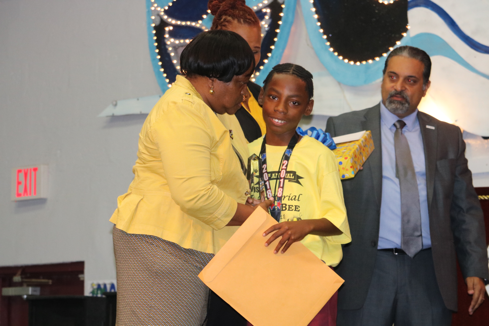 STX Superintendent congratulates JahQuane Graham on his win..jpeg