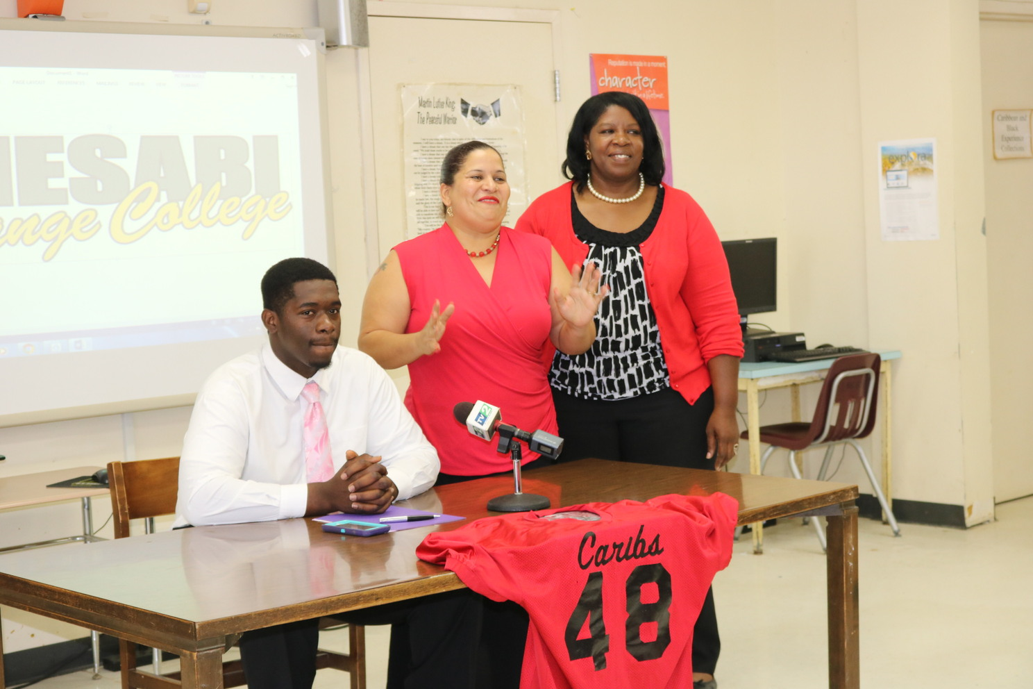 Akil Emanual, coach mom Kemba Martin and his mother Ena Hansen.jpg