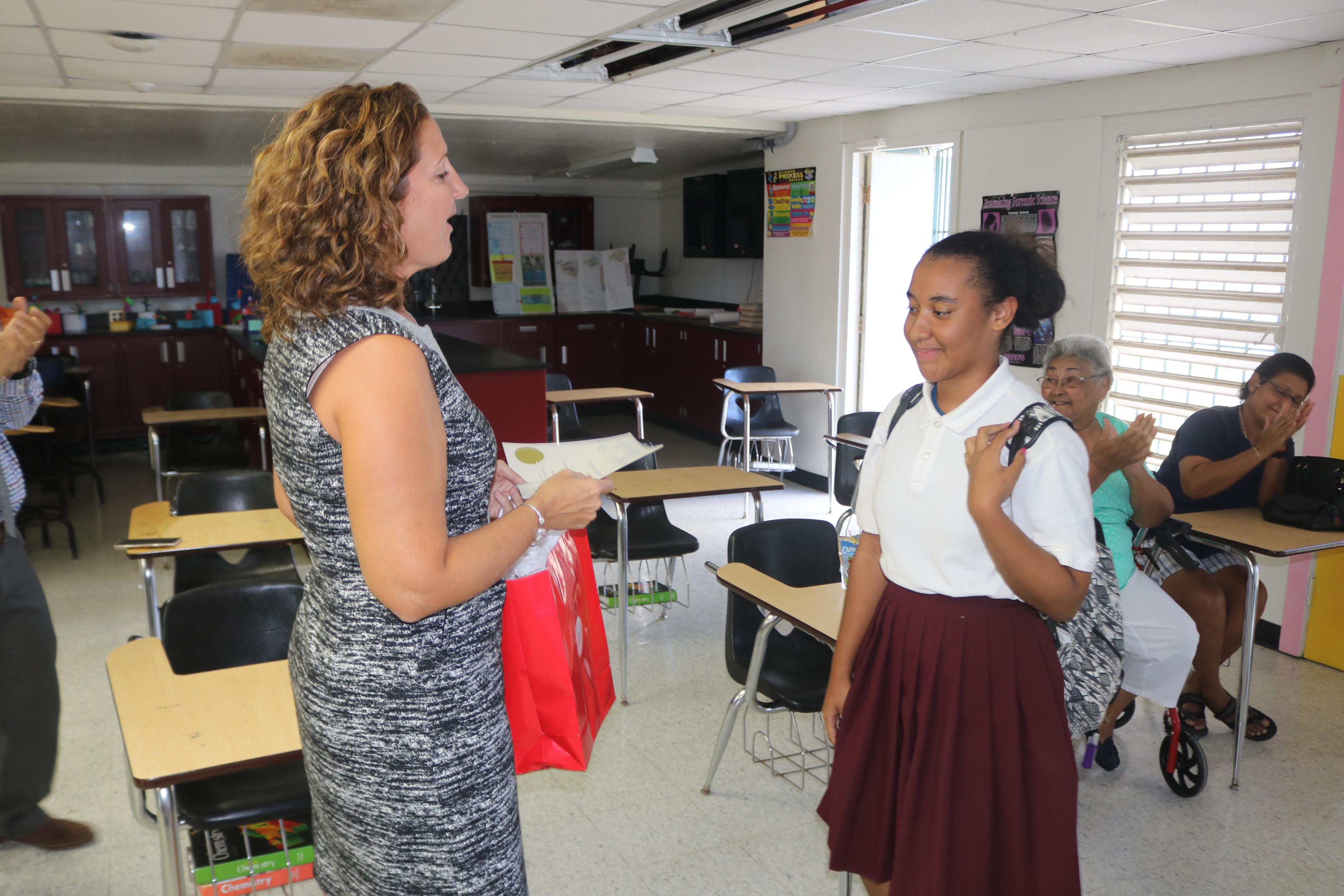 Achieve 3000 Project Manager Julie Eckard presents Kiara Ortiz with certificate and gift. .JPG