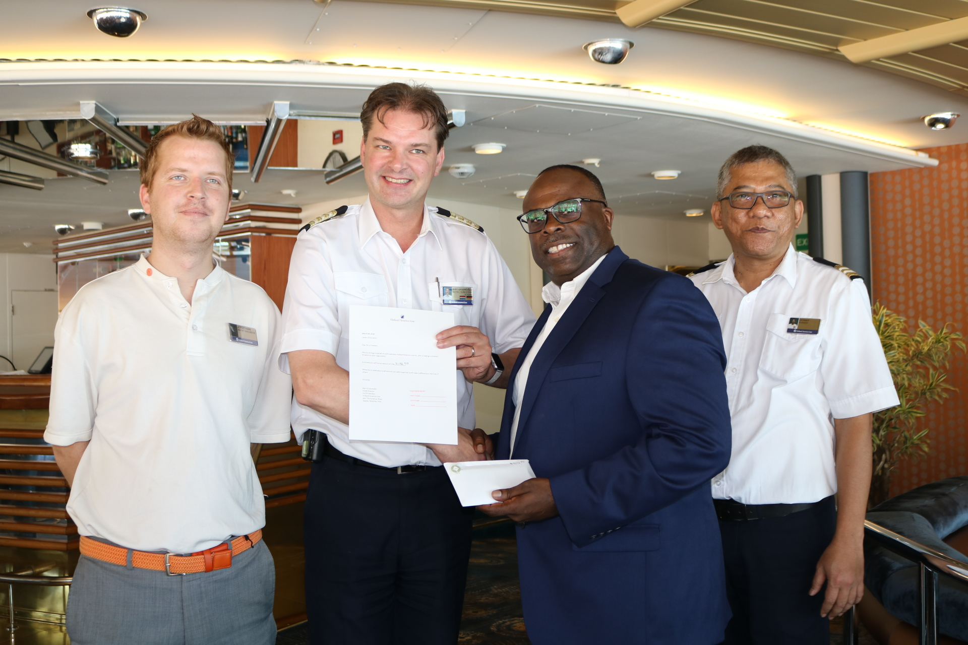 Asst. Cruise Director Jonathan, Hotel Director Bart, Edu. Dir. of Development Steve Walters and Cruise Purser Donny.jpeg
