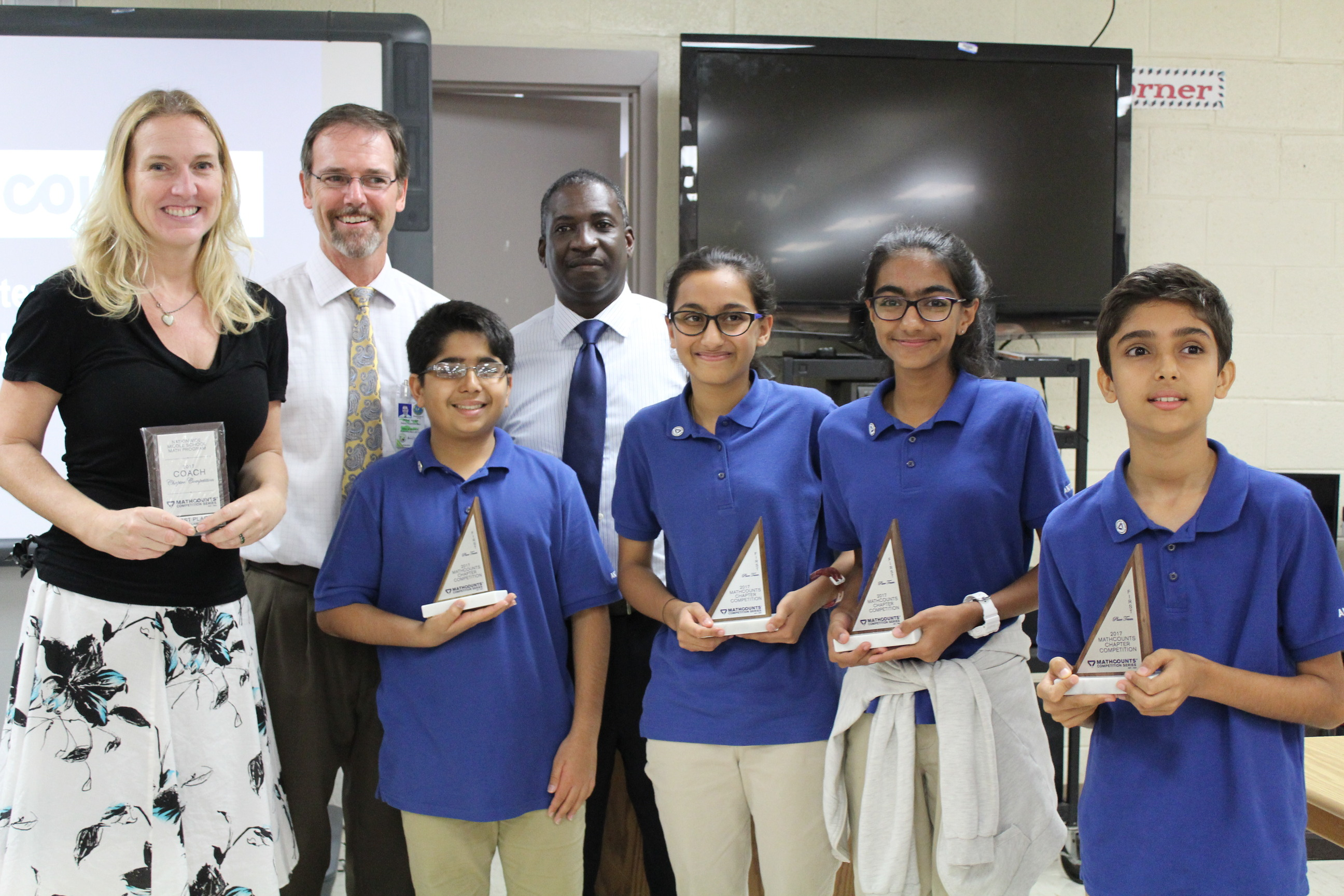 Winning MATHCOUNTS team for STTJ district, Antilles School with coach Michele Humphries, Deputy Superintendent Michael Harrigan and Math coordinator Avon Benjamin.jpg